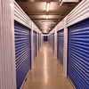 View down a corridor of storage units at MySpace Self Storage at various locations in Central Michigan